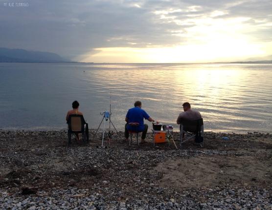 3 generations fishermen enjoy the evening