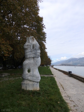 Art pieces by the lake