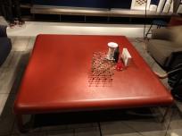 Huge coffee table by red metal sheet