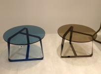 Coffee tables by colored glass at Desalto