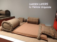 Garden Layers of GAN rugs. A collection made up of rugs, mats, roll pillows and cushions that can be arranged in different ways together, with infinite possibilities for outdoor living.