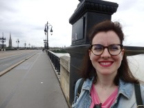 Me happy on the bridge Pont de Pierre