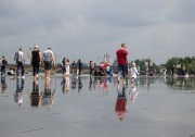 People walking on the Miroir d'eau